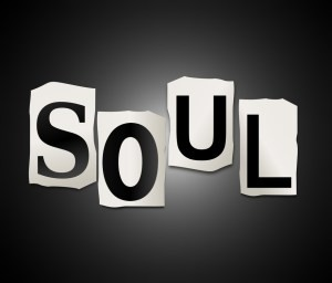 Illustration depicting a set of cut out printed letters arranged to form the word soul.