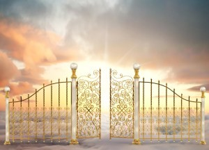 Pearly gates of heaven opening to a high altitude sunrise between two layers of clouds in a landscape orientation